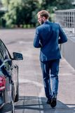 back view of stylish businessman stock images
