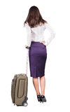 Back view of stylishly dressed brunette business woman with suit. Case looking up. Standing young girl. Rear view people collection.  backside view of person Stock Photography
