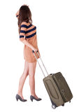 Back view of stylishly dressed brunette woman with suitcase look. Ing up. Standing young girl. Rear view people collection.  backside view of person.  Isolated Stock Photography