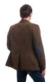 Back view of stylishly dressed man. In a brown jacket Stock Image