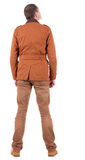 Back view of stylishly dressed man in a brown jackett  looking u Stock Photos