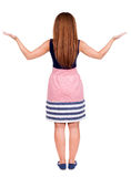 Back view of surprised beautiful  redhead young woman with hands Royalty Free Stock Photography