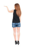 Back view of surprised beautiful  young redhead woman with hands. Up. Girl in blue shotrs. Rear view. Isolated over white. Girl in shorts and heels holding Stock Photography
