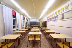Back view of tables and chairs in school class Stock Photography