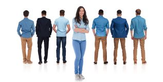 Back view of team of seven colleagues with woman leader stock photos