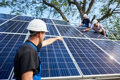 Stand-alone exterior solar panel system installation, renewable green energy generation concept. royalty free stock photography