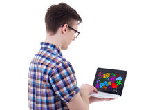 Back view of teenage boy using laptop with media icons and appli Stock Images