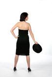 Back view of teenage girl in black dress. Back view of pretty teenage girl in black dress and top hat Royalty Free Stock Photography