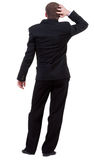 Back view of thinking business man. Royalty Free Stock Photo