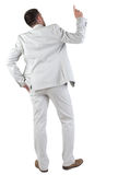 Back view of  thinking young business man in  white suit. Royalty Free Stock Image
