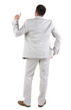 Back view of  thinking young business man in  white suit. Royalty Free Stock Photography