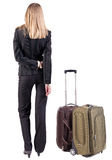 Back view of thoughtful business woman traveling with suitcas. Stock Image