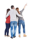 Back view of three friends pointing. Stock Images