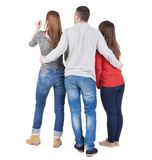 Back view of three friends  (woman and man). Royalty Free Stock Image