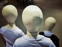 Back view of three manikins in a shop. stock photography