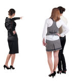 Back view of three young business woman pointing Royalty Free Stock Photography