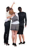 Back view of three young business woman pointing. Royalty Free Stock Image