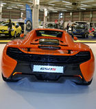 Back view to McLaren650S luxury orange sport car. Stock Images