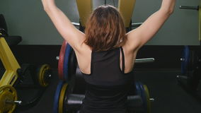 A back view of a trained girl doing exercises. Training for back muscles stock video