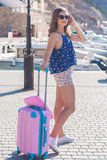 Back view traveler girl with pink suitcase Royalty Free Stock Photos