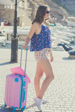 Back view traveler girl with pink suitcase Royalty Free Stock Photography