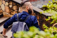 Traveler male with a backpack. Back view of the traveler male with a backpack stock images