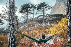 Man traveling in autumn forest by the mountain Stock Images
