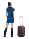 Back view of traveling brunette woman with suitcase Royalty Free Stock Images