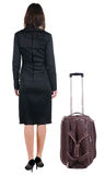Back view of traveling business woman  with  suitcase Stock Photos