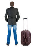 Back view of traveling busness man with  suitcase Stock Photography
