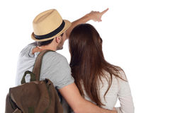 Back view of a traveling young couple. Stock Image