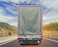 Back view of truck cargo transport container on the high way road. Close Stock Images