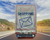 Back view of truck free shipping transport container on the high road Stock Photography