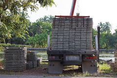 Back view of truck while load stack of prestressed concrete slabs for construction Stock Image