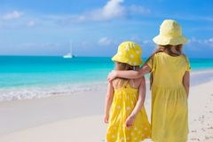 Back view of two adorable little girls on Royalty Free Stock Images