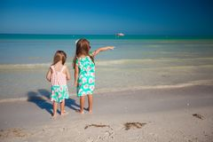 Back view of two little cute fashion sisters on Royalty Free Stock Image
