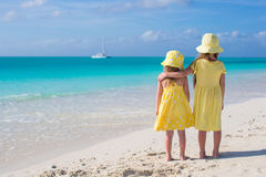 Back view of two little cute girls looking at the sea on white beach Stock Photography
