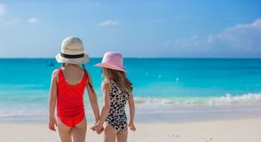 Back view of two little girls looking at the sea Royalty Free Stock Photos