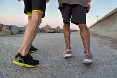 Back view of two male runners in sneakers. Outdoors Stock Photos