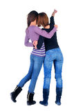 Back view of two pointing women. Royalty Free Stock Image