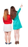 Back view of two pointing young girl. Royalty Free Stock Photography