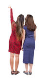 Back view of two pointing young girl. Royalty Free Stock Images