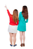 Back view of two pointing young girl. Royalty Free Stock Photos