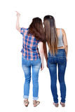 Back view of two pointing young girl. Stock Images