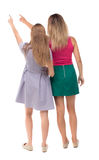 Back view of two pointing young girl Stock Photos