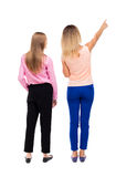 Back view of two pointing young girl. Rear view people collectio Royalty Free Stock Photo