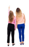 Back view of two pointing young girl. Rear view people collectio Royalty Free Stock Photography