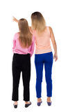 Back view of two pointing young girl. Rear view people collectio Stock Images