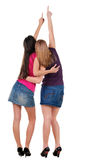Back view of two pointing young women Stock Photo