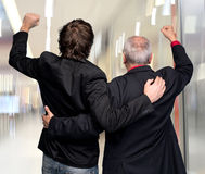 Back view of two winning businessmen Stock Images